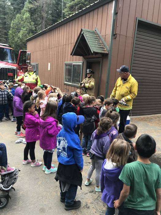 We even got to help the firemen spray the hose!